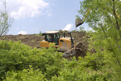 Heavy Equipment Strips Vegetation Royalty Free Stock Image
