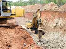 Heavy Equipment at Work. Machinery working at a construction site Royalty Free Stock Photos