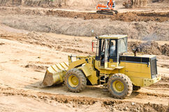 Heavy excavator loader at soil Stock Photography