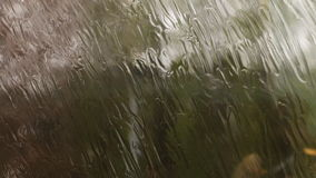 Heavy fall of rain observed through fast train window. stock footage