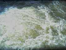 Heavy and fast flow of river water stock photo