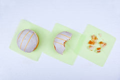 Heavy and fatty treats. Donut on kitchen scales. Concept Stock Photography