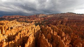Heavy fluffy grey rain clouds moving in sky over amazing red orange sand stone cliff mountain range desert canyon in 4k stock video footage