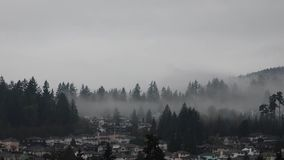Heavy fog fly low cover mountain Stock Photography