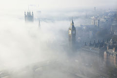 Heavy fog hits London. Palace of Westminster in fog seen from London Eye Royalty Free Stock Photo