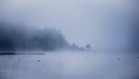 Heavy fog on horizon, rising off the Ottawa River. Royalty Free Stock Photos