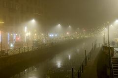 Heavy fog on Naviglio Grande at Xmas time, Milan, Italy Stock Photo