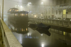 Heavy fog on Naviglio Pavese at Xmas time, Milan, Italy Royalty Free Stock Photos