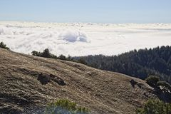 Heavy fog over the Pacifi Ocean in San Francisco. View of the San Francisco Bay Area from the top of Mountain Tamalpais in the Marin County Area, blue sky, fogs royalty free stock image