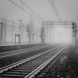 Heavy fog shrouds an empty railroad track Stock Photography
