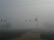 Heavy fog and traffic lights with patched roads Stock Images