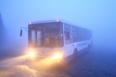 Heavy fog. UFA, RUSSIA - JANUARY 28, 2010: White NEFAZ 5299 suburban bus at the bus station during a heavy fog Stock Photo