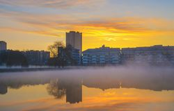 Heavy fog on water in morning city park Stock Photo