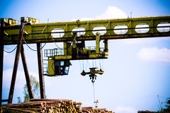 Heavy forest loader/crane in manufacturing stock photos