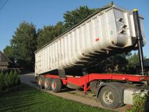 Heavy freight trailer. Big heavy freight aluminium trailer, lifted up Royalty Free Stock Images