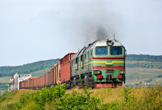Heavy freight train pulled by diesel locomotive Royalty Free Stock Photos