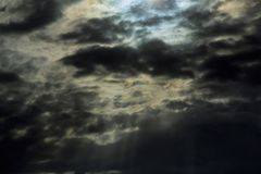 Heavy gale black stormy clouds Dramatic Thunderclouds. Dramatic Thunderclouds Heavy gale black stormy clouds Light in the Dark and Dramatic Storm Clouds Royalty Free Stock Images