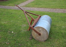 Heavy gardening lawn roller with rusty pull Royalty Free Stock Images