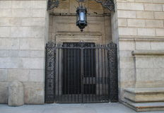 Heavy gate at entrance of stone building Royalty Free Stock Images