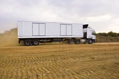 Heavy Goods in Transit via Dirt Roads Stock Photography