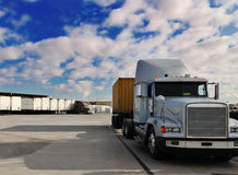 Heavy goods truck leaving loading bay stock image