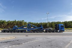 Heavy goods vehicle on the parking lot of a German motorway. A heavy goods vehicle takes a day break on a German motorway royalty free stock photo