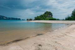 Heavy gray clouds surging above the calm Andaman Sea Royalty Free Stock Image