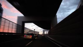 Heavy gray rain cloud in sky over busy traffic highway road in first person pov on amazing view from wind shield glass. Heavy gray rain cloud in sky over busy stock footage