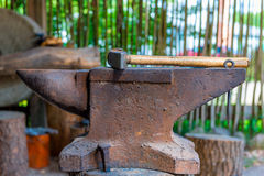 Heavy hammer on the anvil in the forge Royalty Free Stock Photography
