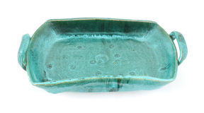 Heavy hand made green stoneware ceramic tray Stock Images