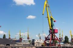 Heavy harbour jib cranes. Stock Image