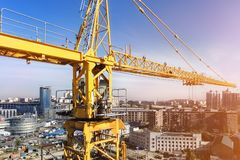 Free Heavy High Tower Crane View At Skyscraper Conctruction Site. Industrial Building Background Royalty Free Stock Images - 144907709