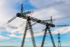 Heavy high voltage electric pylon and power transmission line. royalty free stock photography