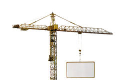 Heavy hoisting crane with advertisement hoardin Royalty Free Stock Photos