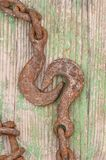 Heavy hook. Close up of very rusty hook and chain Stock Images