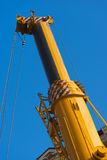 Heavy Hydraulic Crane on Blue Sky Royalty Free Stock Images