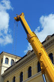 Heavy Hydraulic Crane on Blue Sky Royalty Free Stock Image