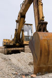 Heavy hydraulic machines. Old excavator with a rusty bucket Stock Photography