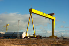 Heavy industrial cranes in the famous Harland and Wolff shipyard Stock Photos