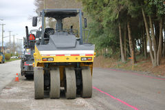 Heavy Industrial Equipment for Road Paving. Heavy duty industrial equipment is used in preparation for road paving Royalty Free Stock Images