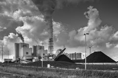 Heavy industrial plant with pipes and smoke Royalty Free Stock Photography