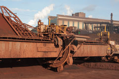 Heavy industry. Heavy steel works industry. Large brown machine, smoke and some blue sky royalty free stock photos