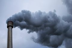 Heavy industry. Industrial chimney with great amount of smoke Stock Photo