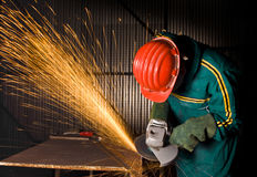 Heavy industry manual worker with grinder Stock Photography