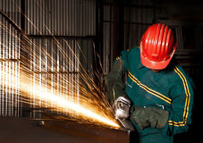 Heavy industry manual worker with grinder stock photo