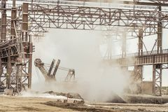 Heavy industry plant shop. Hot dump in metallurgical industry royalty free stock images