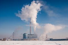 Heavy industry plant with steam and fumes Stock Photography