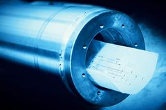 Heavy industry steel cylinder, piston with industrial plans. Stock Photography
