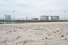 Heavy industry vs Nature. Heavy industry structures on a beach in Portugal Stock Photography