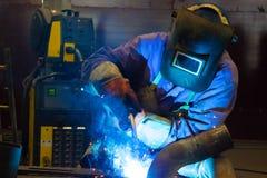 Heavy industry. Welder welding tubes in factory,photography Stock Photos